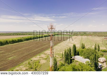 Telephone Mast Of Cell Site Tower With 5g And 4g Base Station. Aerial View Of Telecom Antenna