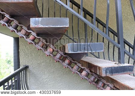 Closeup Of Large Stairs Made With Large Machinery Chains