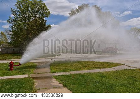 A Fire Hydrant Is Open As The System Is Flushed And Tested For Operational Use When Needed.