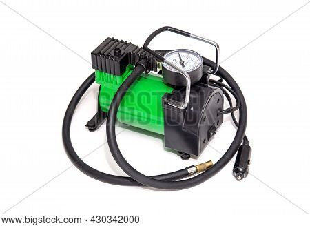Car Pump With Manometer, Green Air Compressor On White Background. Inflating The Wheels With Air In
