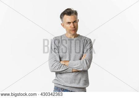 Image Of Angry And Disappointed Middle-aged Man, Being Offended Or Displeased, Frowning And Grimacin