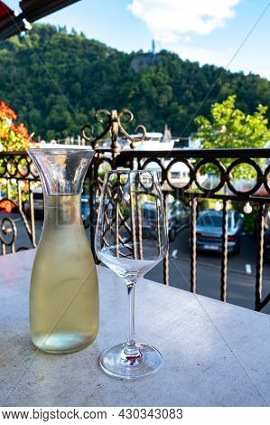 Tasting Of White Quality Riesling Wine Served On Outdoor Terrace In Mosel Wine Region And Old German