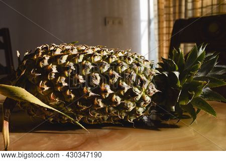 Pineapple Fruit. Sweet Delicious Fruits With Wooden Background. Top View Of Pineapple