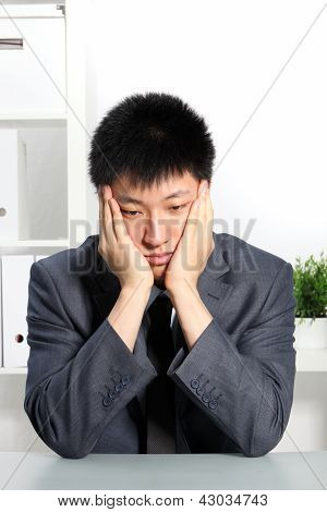 Despondent Asian Businessman