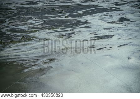 Atmospheric Landscape With Many Channels Near Shallow Lake. Minimal Backdrop Of Dark Green Water In