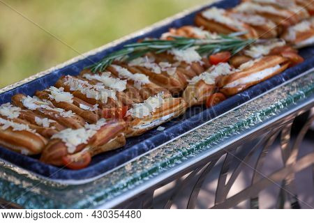 Eclairs With Savory Fish And Soft Cheese Filling With Vegetables