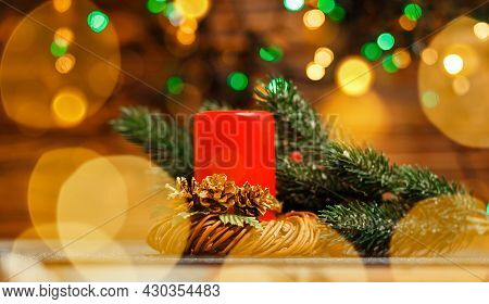 Burning Candles Over Old Wooden Table With Bokeh Lights. Christmas Candles And Lights. Festival Cand