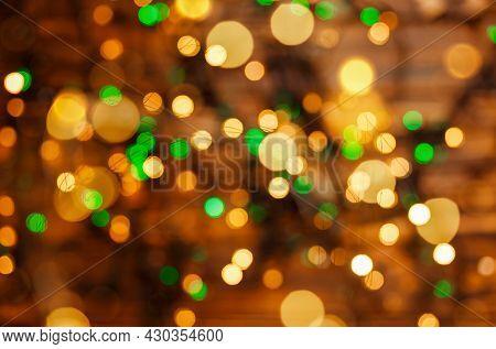 Defocused Gold Lights. Abstract Holiday Background. Beautiful Shiny Xmas Lights. Glowing Magic Bokeh