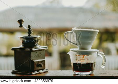 Drip Brewing Coffee With Smoke And Coffee Grinder On Wooden Bar In Morning, Drip Brewing Coffee Conc
