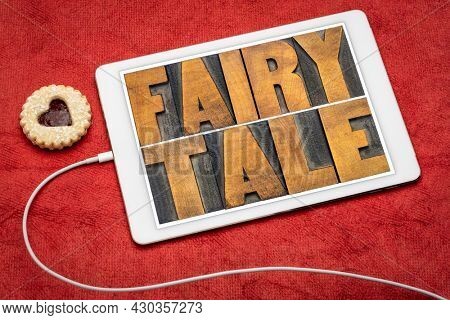 fairy tale - word abstract in vintage letterpress wood type on a digital tablet
