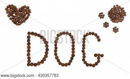 Dry Dog Food In The Shape Of A Heart, Dog Paw And Letters Dog, Isolated On White Background. Heart S