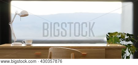 Copy Space On Wooden Work Table With Mountain Landscape Panorama View