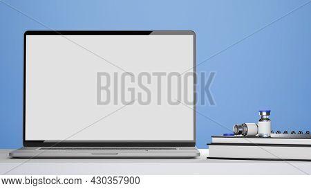 Laptop Blank Screen Mockup, Vaccine Bottles, Medical Books On Doctor Or Pharmacist Office Desk