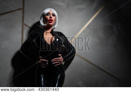 Sexy Woman In A Blonde Wig And Latex Catsuit. Role-playing Games