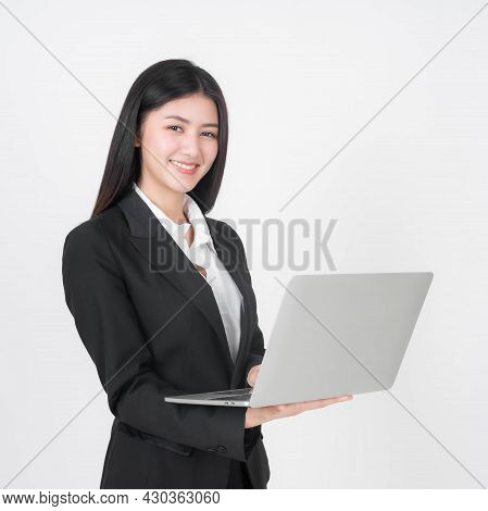 Portrait Of A Business Woman , Beautiful Asian Girl Using Laptop Computer Isolated On White Backgrou