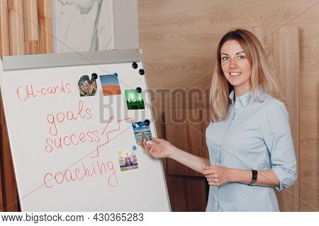 Woman Young Adult Coach Coaching With Oh Cards On Whiteboard Flipchart Indoor Training Psychology Co