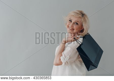 Elderly Caucasian Old Aged Woman Gray Haired Going Shopping With Bag On Gray Background