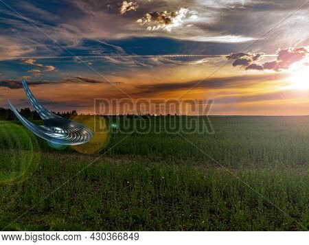 Ufo Landing Over An Agricultural Field In The Rays Of A Sunset. Unidentified Flying Object. Flying S