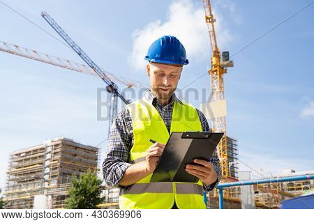 Osha Inspector At Construction Site. Young Engineer Worker
