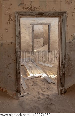 Abandoned Building Interior With Floor Covered By Desert Sands From Kolmanskop Town In Namibia