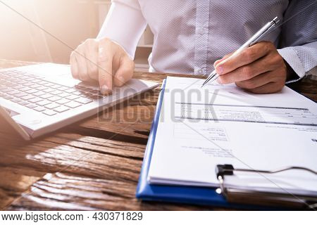 Charters Business Accountant Checking Tax Invoice In Office