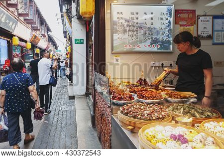 Shanghai, China - September 2019: Local Street Food And Snacks Sold At The Qibao Old Street In Qibao