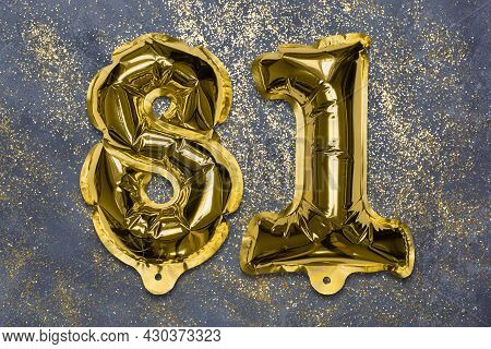 The Number Of The Balloon Made Of Golden Foil, The Number Eighty-one On A Gray Background With Sequi