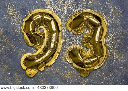 The Number Of The Balloon Made Of Golden Foil, The Number Ninety-three On A Gray Background With Seq
