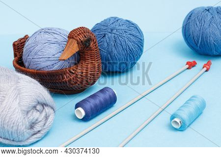Woolen Yarn For Knitting. Balls Of Natural Wool Yarn And Knitting Needles