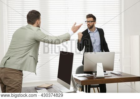 Emotional Colleagues Arguing In Office. Toxic Work Environment