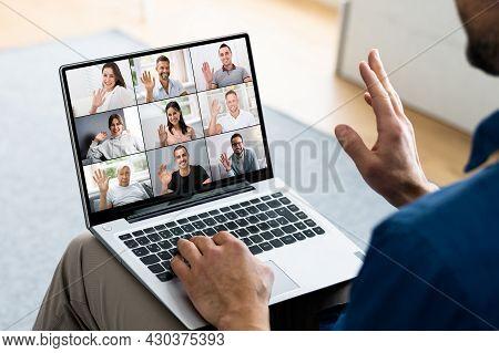 Remote Teleworking Meeting Call On Computer. Waving Hand Saying Goodbye