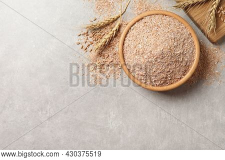 Wheat Bran On Light Table, Flat Lay. Space For Text