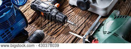 Electric Power Tools In Workshop. Repair Toolbox