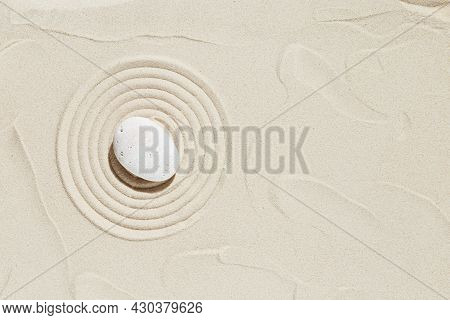 Aesthetic Minimal Background With Zen Stone On Sand. Pattern In Japanese Zen Garden With Concentric