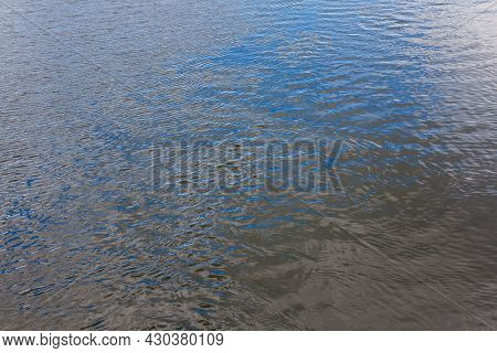 Real Life River Water Surface With Ripples At Summer Day - Full Frame Background