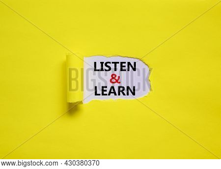 Listen And Learn Symbol. Words 'listen And Learn' Appearing Behind Torn Yellow Paper. Beautiful Yell