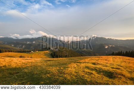 Traditional Alpine House  And Mountain Pastures At Sunset In Summer. Panoramic View On Mountain Vall