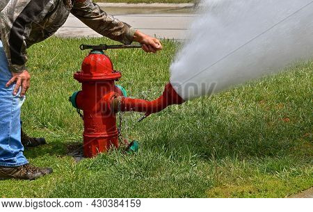 A Fire Hydrant Is  Being Opened  As The System Is Flushed And Tested For Operational Use When Needed