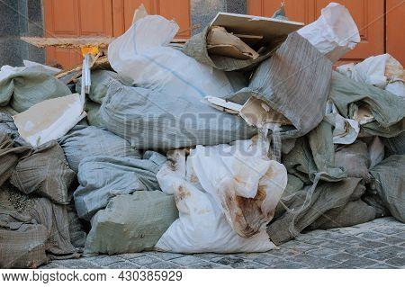 Bunch Of Trash. Construction Garbage, Cardboard, Polyethylene After Building Repair. Removal Of Debr