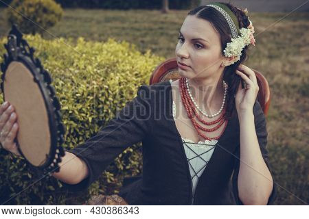 Portrait Of Brunette Woman Dressed In Historical Baroque Clothes With Old Fashion Hairstyle