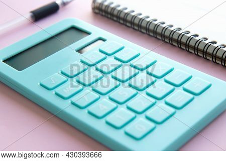 Mint Calculator, Notebook And Pen On Pink Background