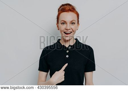 Young Excited Overjoyed Ginger Female Being Mentioned Or Being Choosen By Someone, Pointing At Herse