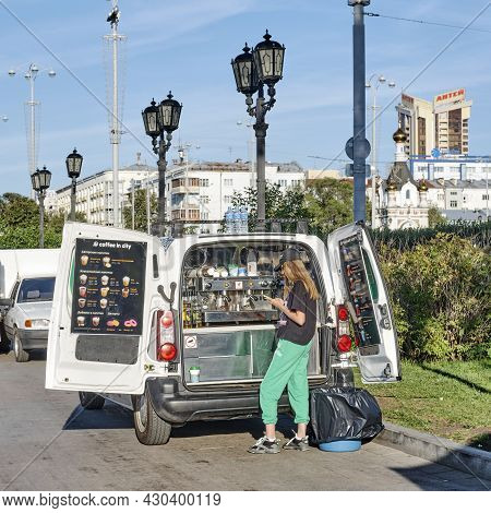 Yekaterinburg, Russia - August 12, 2021: Near Mobile Coffee Shop On Wheels Cute Barista Girl, Using