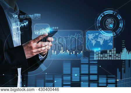 Businessman Hand Holds Smartphone, Blue Hologram Glowing Digital Information Security Interface. Con