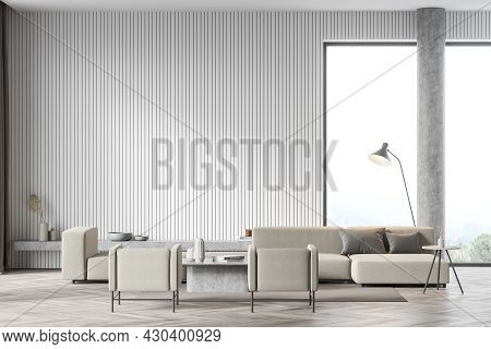 Living Room Interior With Large Beige Sofa, Two Comfortable Armchairs, Carpet, Column And Panoramic