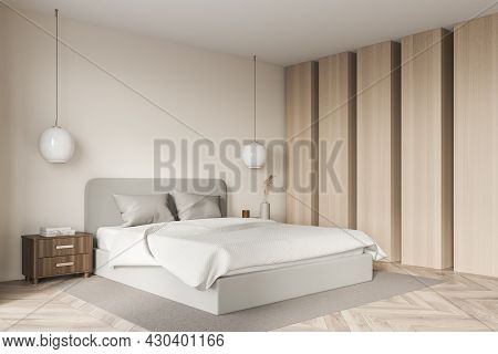 Bright Bedroom Interior With Large Bed, Closet, Wardrobe, Carpet, Lamps And Oak Wooden Parquet. Conc