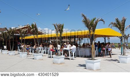 Fire Island, New York, Usa - 24 July 2021: People Sitting At A Bar Attached To The Concession Stand