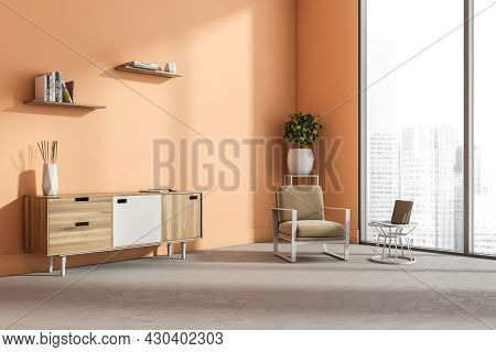 Living Room Interior With Panoramic Window, Beige Armchair, Peach Colour Wall, Laptop, Bookshelf And