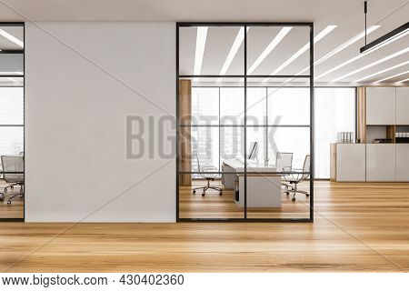 Corridor With Panoramic Ceo Office Behind The Black Frame Glass Partition And Empty White Wall Betwe