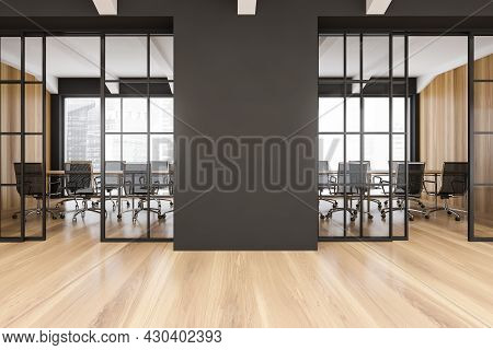 Office Interior Of A Modern Company With Empty Space, Parquet Floor And Dark Partition Between Slidi